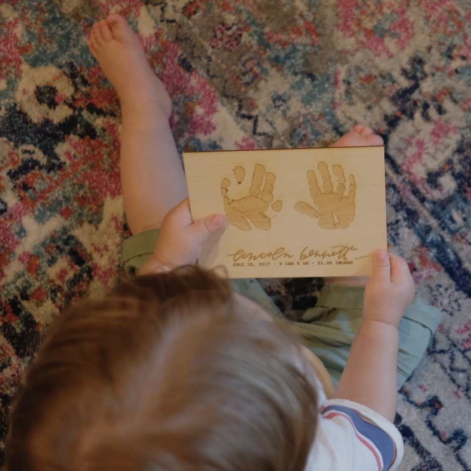 Little Joys Collection — Lincoln Handprints · These little handprints (or paw prints!) are engraved into wood and adorned with your little one's name (hand lettered) and any information you want listed. I can't wait to celebrate your little ones with you!
