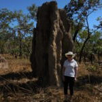 Me standing in front of an enormous magnetic north termite mound in Litchfield National Park in the Northern Territory.