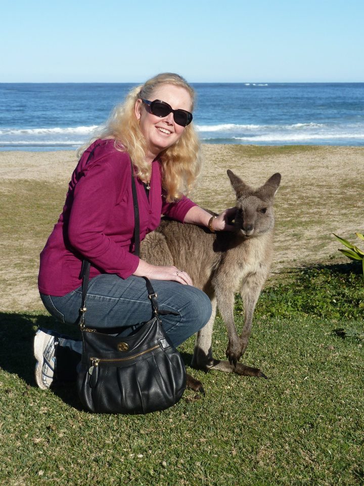 Me patting a kangaroo at Pebbly Beach, South Coast NSW