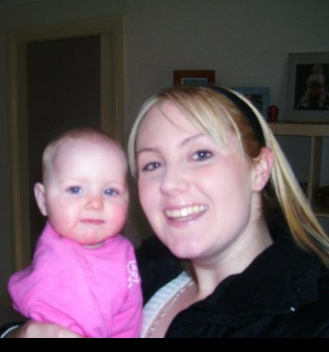 Blurry snap in 2005 a 19 year old me and my 5 month old new baby!
