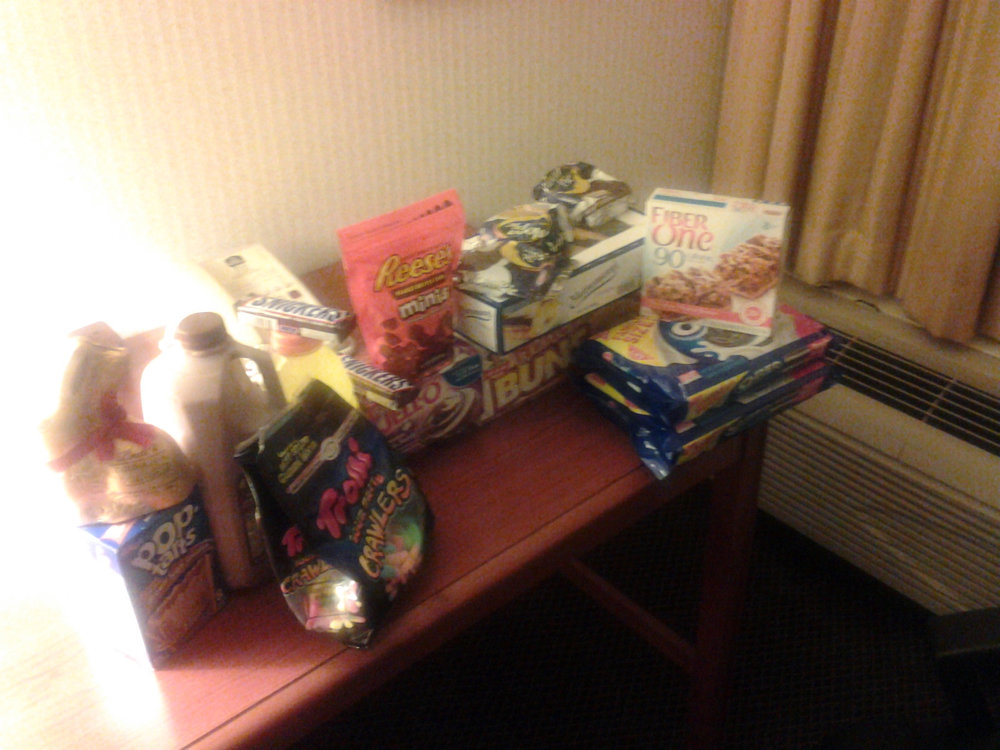 "The ""binge stash"" I had accumulated and kept at the hotel for after my show. This was the last picture I took of this food while still thinking this was ""funny""."
