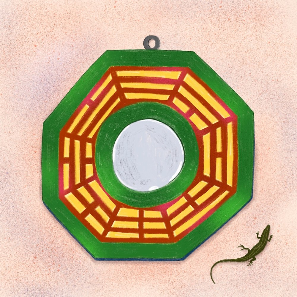 Bát quái (Vietnamese for mirror-8-bowl) or bagua (Chinese)—not uncommonly seen hung above entranceways as part of a feng shui practice. Correct placement can help diffuse negative energy.