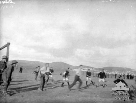 The team from the destroyer HMS Hunter playing a game of soccer against a 6th Battalion team at a camp on the Aegean island of Lemnos. Australian War Memorial. -