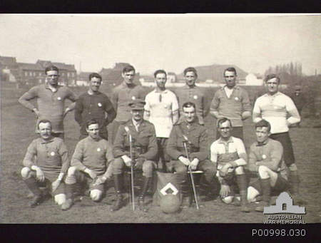 England,1919-04-05. 2nd Pioneer Battalion Soccer Team wearing the silver medals they won in the divisional competition. Australian War Memorial -