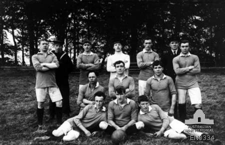 Group portrait of the soccer team representing the crew of HMAS Sydney. HMAS Sydney was at the southern naval base of the Royal Navy's Grand Fleet, near the Forth of Firth, Scotland, during a break from patrols of the North Sea with the 2nd Light Cruiser Squadron. Australian War Memorial -