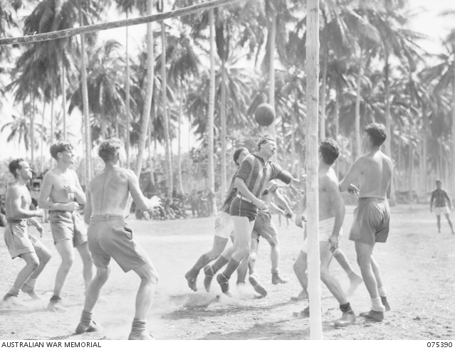 LAE, NEW GUINEA. 1944-08-19. AN EXCITING MOMENT DURING THE SOCCER MATCH BETWEEN A TEAM FROM THE HMAS