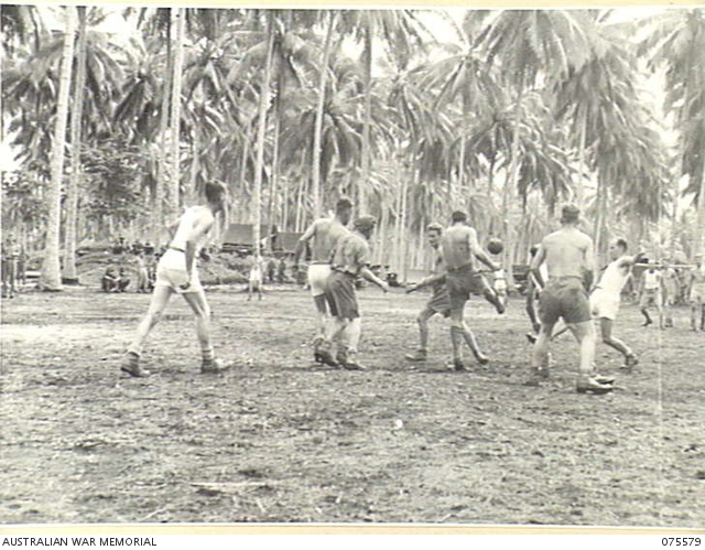 MILILAT, NEW GUINEA. 1944-08-31. AN EXCITING INCIDENT DURING THE SOCCER MATCH BETWEEN SINGLE AND MARRIED MEN OF THE 5TH DIVISION SIGNALS. -