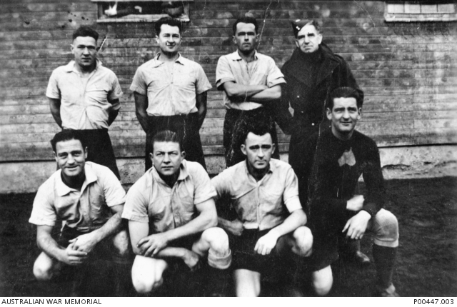 The Australian soccer team at Prisoner of War camp Stalag XVIIIa at Wolfsberg, Austria. Soccer was played in a small area between prison barracks with seven men to a team. All team members were from NSW, Victoria and SA. -
