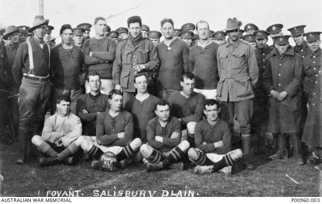 The 1st Pioneer Battalion football team with supporters standing behind the team. The men are probably reinforcements for the 1st Pioneer Battalion at the Pioneer Training Battalion. -1916 -