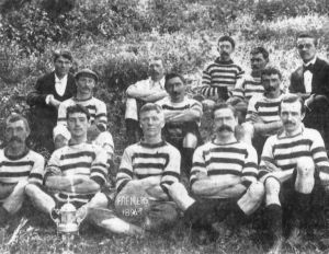 Fremantle Wanderers proudly pose with WA's first league trophy in 1896. - Fremantle Wanderers won the first league championship and went on to add three more titles in the next five years. In those days, Freo played at a ground called the Halfway House in Cottesloe, but had to move when the adjoining Albion Hotel on Stirling Highway took over the entire site.(Football Hall of Fame WA)