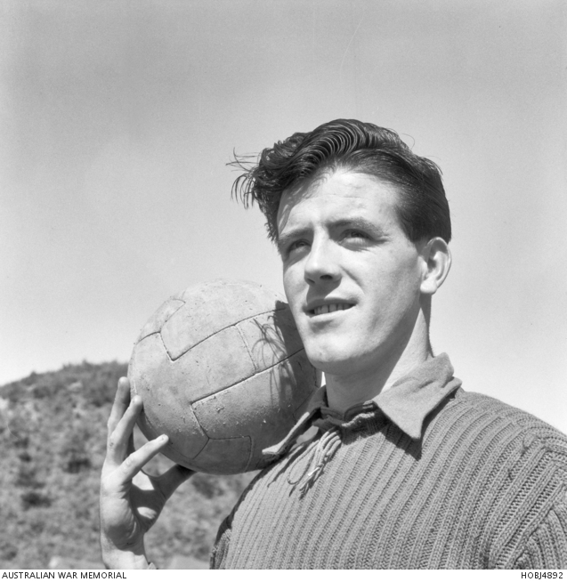 Korea. 21 March 1954. Informal portrait of Private (Pte) Frank (Paddy) Gahan, 2nd Battalion, The Royal Australian Regiment (2RAR), of Adelaide, SA, holding a soccer ball. Pte Gahan represented Ireland in international soccer competitions and played for the Whitehall Rangers in Dublin. In Adelaide he was one of the stars of the Juventus team. -