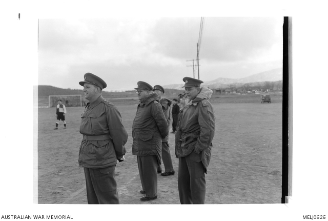 Lieutenant General (Lt Gen) R Bierwirth, Commander in Chief, British Commonwealth Forces Korea (BCFK), watches a soccer match being played between the 1st Battalion, The Royal Australian Regiment (1RAR), and a team from the Britcom Field Dressing Station at Tokchon, Korea. -