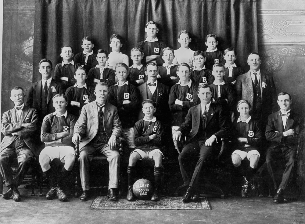 Queensland Schoolboys Soccer Team, 1922 - Back row - V. Nuol, J. Salmon, E. Brown, D. Lord, E. Kruck. Second row - E. Erbs, J. Henderson, C. Warrell, L. Taylor, A. Gillingwater, E. Brown. Third row - L. McCurley (NSW), L. Taylor, L. Merier, A. Merier (Com), S. Johnson, C. Ross, J. B. English (NSW). Front row - R. L. Jackson (Com), H. Franke, E. McGregor (Chairman Q. S. F. A.), J. Cox, D. W. Nicol (Hon. Sec. Q. S. F. A.), L. Scott, W. Betts (Hon. Sec. Q. F. A.).(StateLibQld)