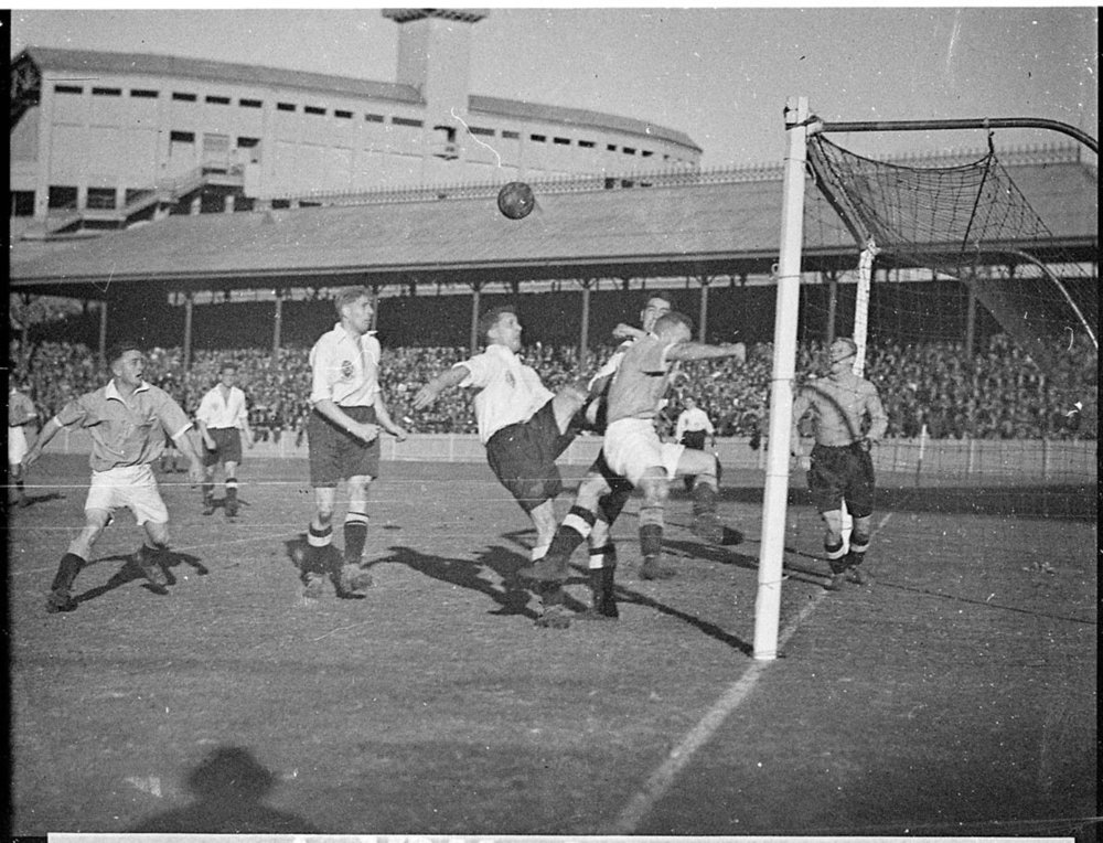Goalmouth scramble in the game between New South Wales and the touring England amateur team, Sydney Showgrounds, 3 July 1937. England won 3-1. - (State Library of NSW)