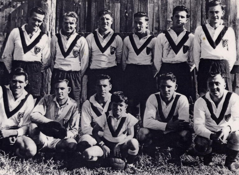1943-Balgownie Rangers - Back: W Cram, L McCann, R McKinnon, C Coupe, M Barwise and N Barwise;Front: W Tolson, R Henson, A Miley, K James, & F Dal Santo;Mascot: Brian Wellington.
