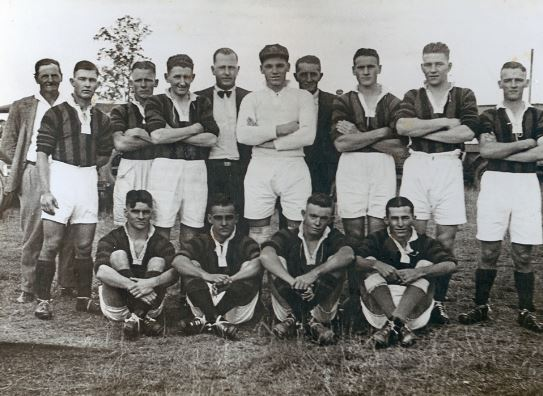 Ipswich Junior Soccer Team?, Ipswich, 1935   - At a match against the New South Wales Protestant Churches Association. Back row- D. Johnson (Referee), S. Purnell, T. Johnson,R. Jones, J. Maxwell (President), M. Richardson, W. Smith (Secretary), G. Dale, T. Purnell, A. Parsons. Front row- J. Bell (Captain), G. Williams, K. Wall, D. Warren. The team colours were blue and gold. (Ipswich Libraries)