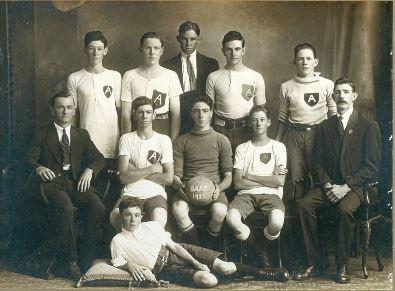 Bundamba Junior Minor Athletic Football Club, Bundamba, Ipswich, 1922 - Back row: J Chandler, A Knott, H Kitching, C Bridley (Vice-Captain), R Dobbie. Sitting: J Dowse (President), A Chandler, P Massey (Captain), A Pocock, A Chandler (Vice – President). In front: J Allan. Inset: R Smith, Edred Seymour (posthumous, born 1907 died 1922), E Miller(Ipswich Libraries)