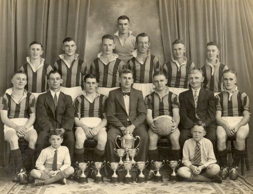 Blackstone Rovers Football Club, Ipswich, 1940   - Winners, Reserve Premiership, Q.S.F.A., and runners-up, Brough Cup. Names listed: Team members: Back row- W. Evans, Second row- S. Clarkson, A. Dowell, I. Reeks, R. Gould, F. Tite, J. Evans. Sitting- T. Williams, T. Rush (committee), M. Evans (vice-captain), B. Dobbie (secretary), J. Rush (Captain), W. Parker (committee), V. Campbell. In front- D. McKenna, J. Dobbie