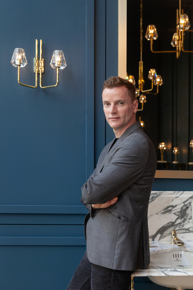 Gestalt Creative Director and co-founder Christopher Jenner alongside the bathroom-friendly  Aquiline Twin Arm Wall Light .