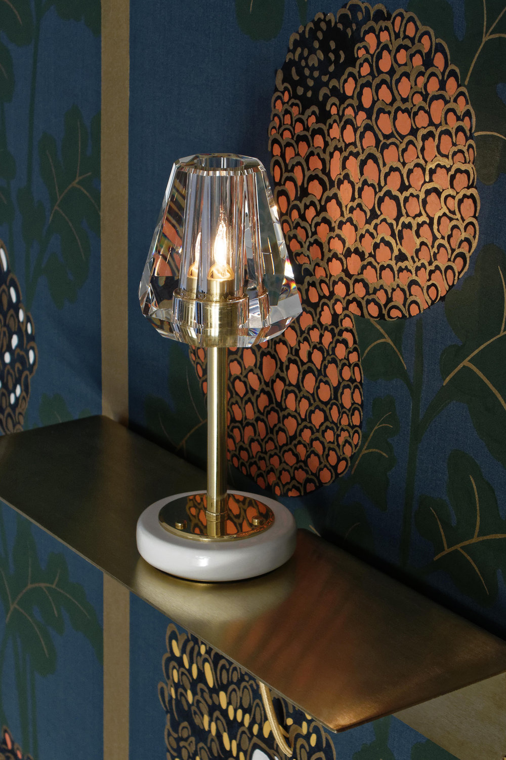 The Aquiline Single Arm Table Lamp with a striking handpainted Fromental wallcovering.