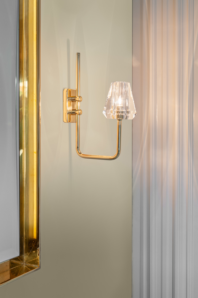 The  Aquiline Single Arm Wall Light  can be used throughout the home, including the bathroom.