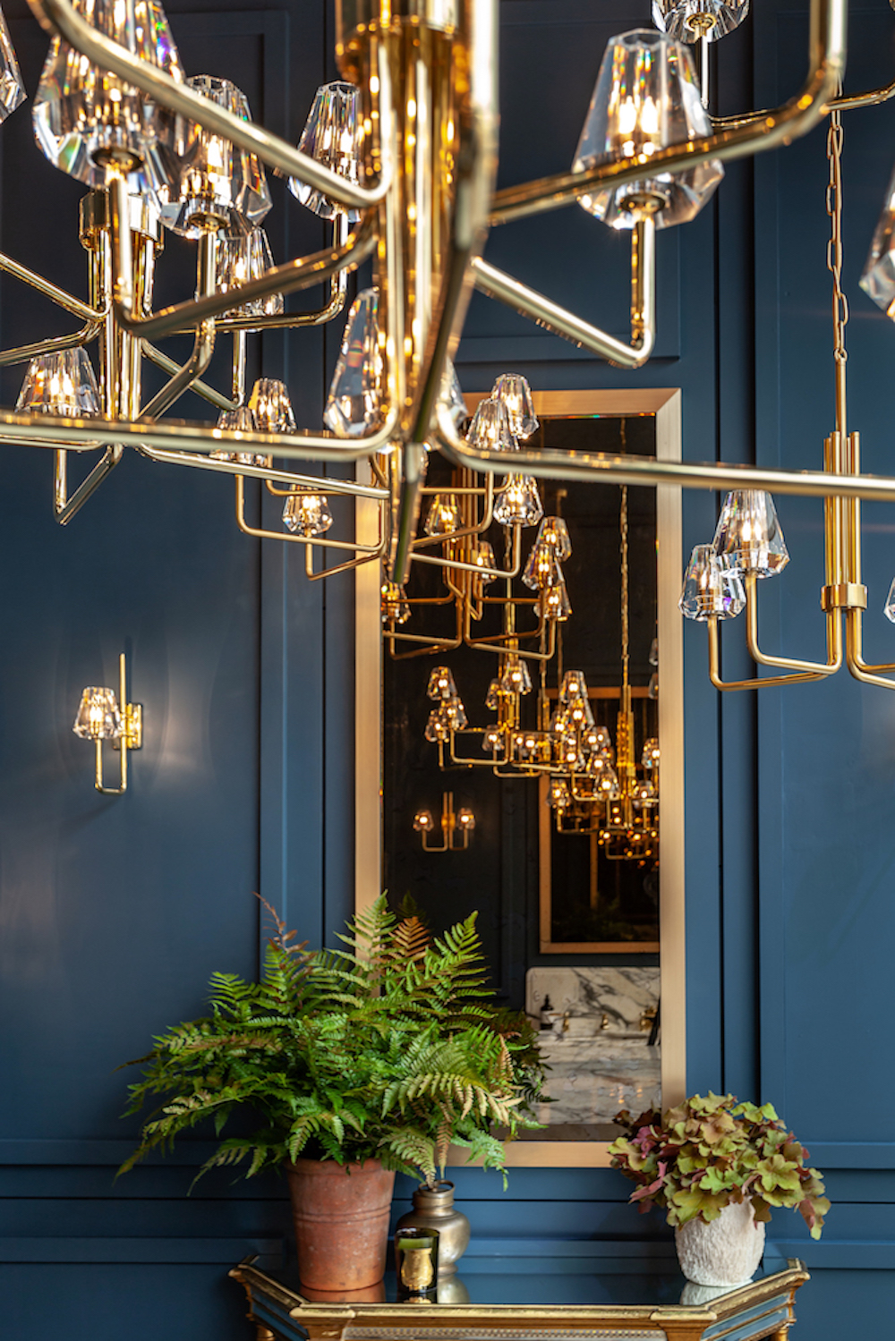 The  Aquiline Eight-Arm Chandelier  is the ultimate statement piece for larger spaces. Its double height arms and broad span make it a perfect choice for accentuating height and architectural features.