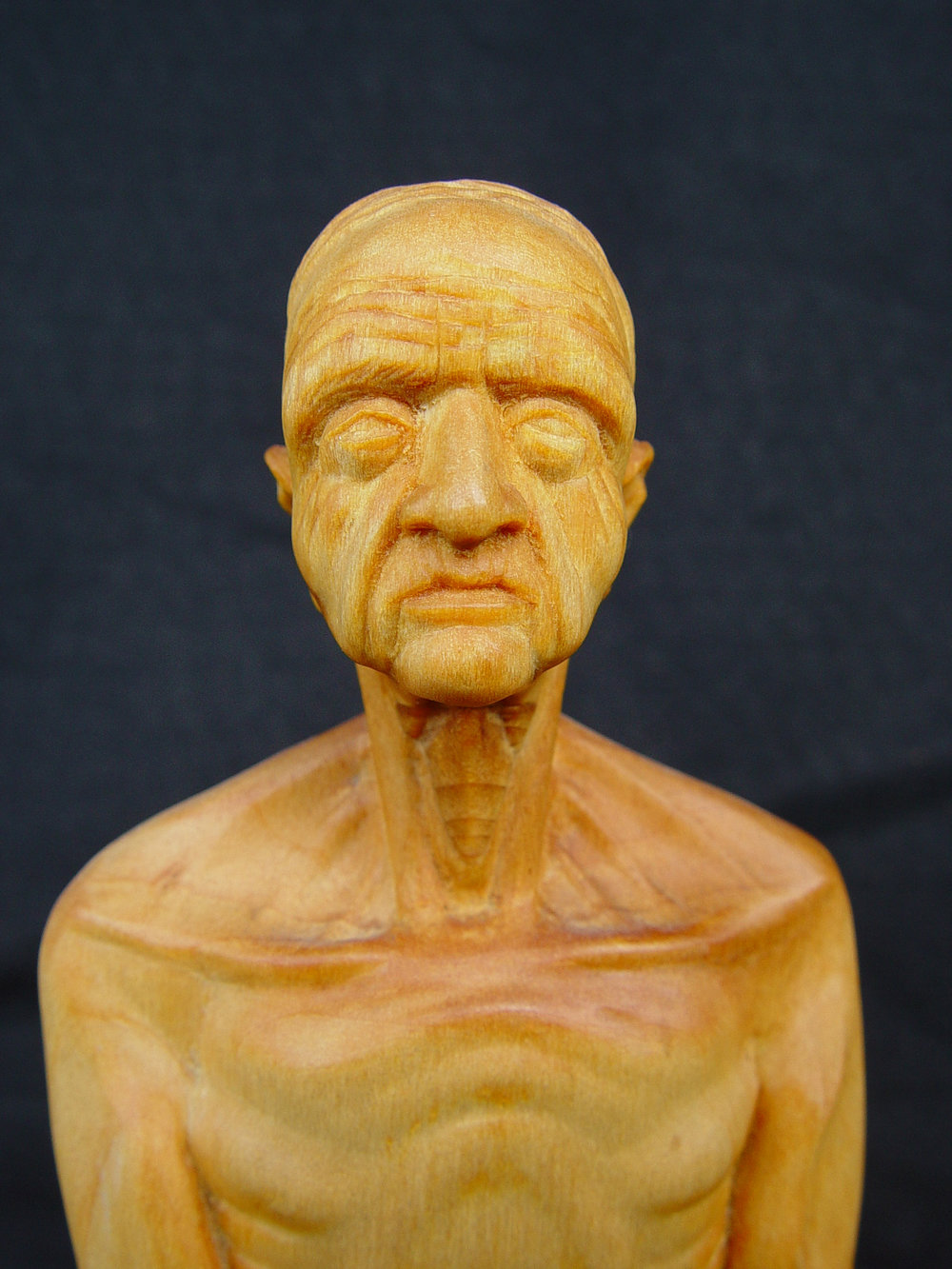 "Old man, 10"" tall, basswood."