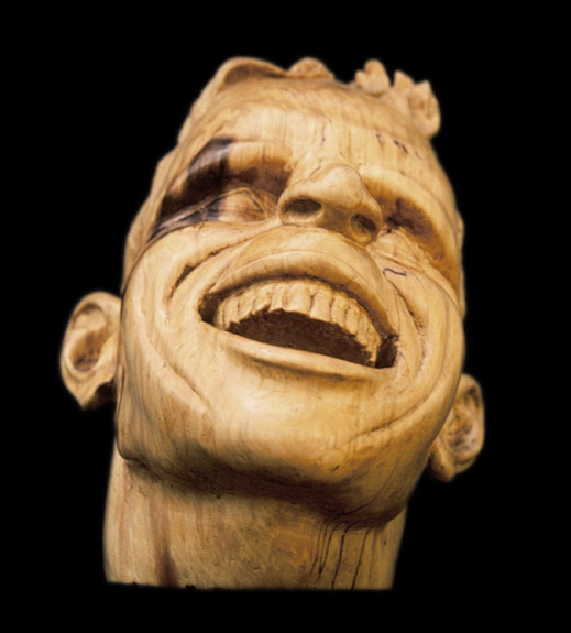 "Laughing Man, 10"" high, Basswood."