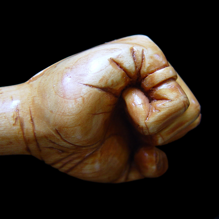 "Miniature fist (modeled after fist carved for The Clearwater, also complete by Steff Rocknak). Presented to Pete Seegar, 1/2"" tall."