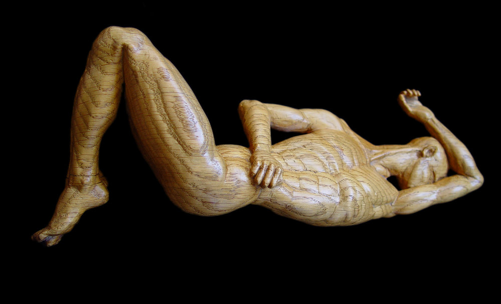 "Contortion, oak, 10"" long."