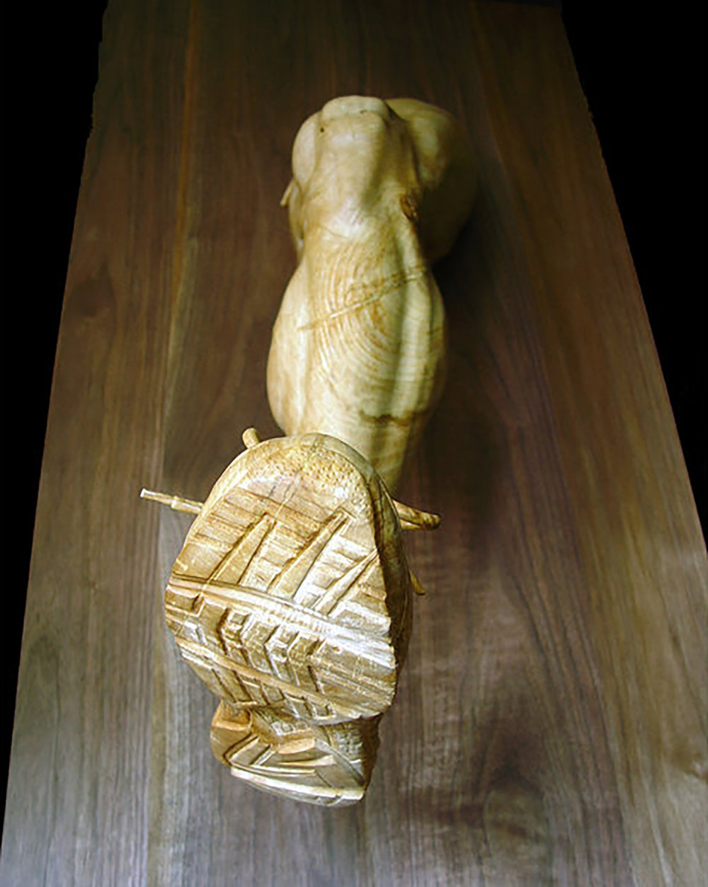 The Runner: Mounted on black walnut, part of a three-part piece, The Triathlete, life size.