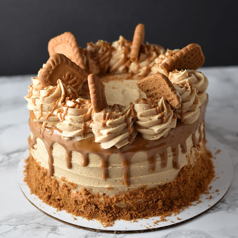 Biscoff Cookie - If you have an obsession with cookie butter like we do, than this is the cake for you. Vanilla cake layers frosted with cookie butter frosting. Cookies and biscoff butter take it to the next level.