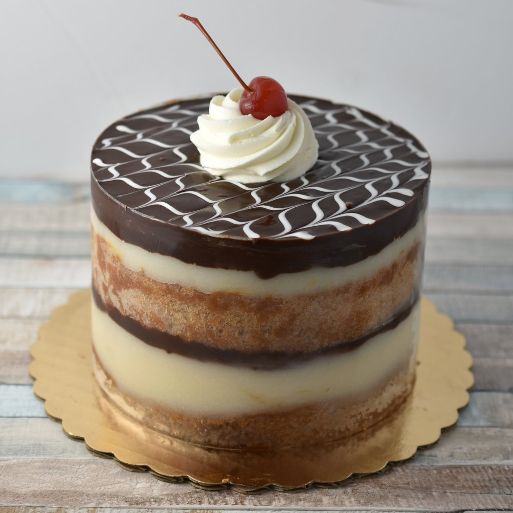 Boston Cream - Just like the Boston cream you know and love. Vanilla cake, scratch made pastry cream, and our rich ganache to top it off. Yes please!