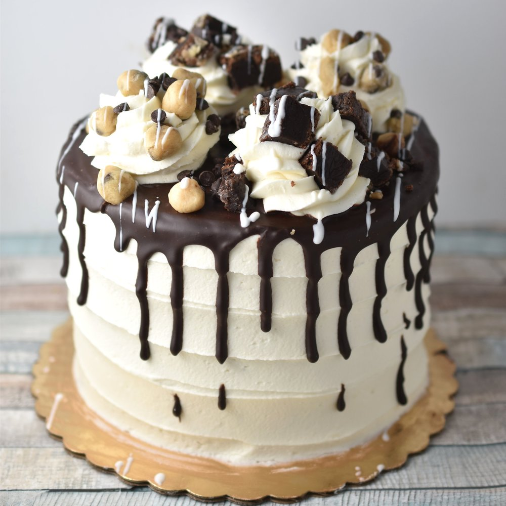 A little Baked - You like cookie dough? You like brownies? We can put them together to make the perfect cake inspired by the amazing ice cream flavor. marble cake filled with chunks of our fudge brownies and homemade cookie dough, and frosted with soft vanilla buttercream. Heaven in your mouth people.