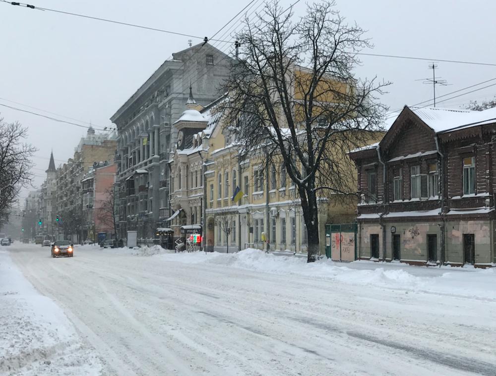 Snowy street in Kyiv, Ukraine by Peter Santenello