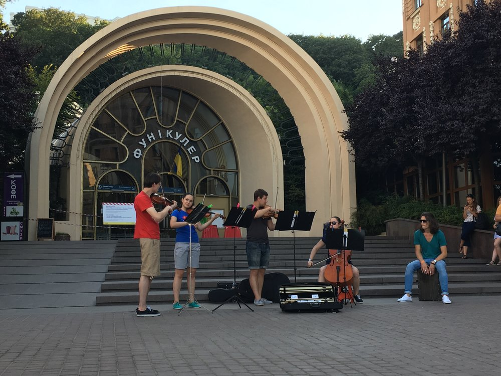 Street musicians near the funicular in Kyiv, Ukraine