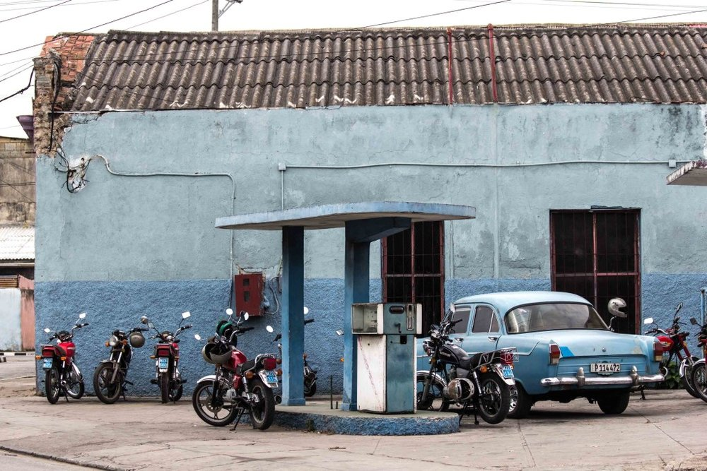 Motorcycles and a car on the gas station