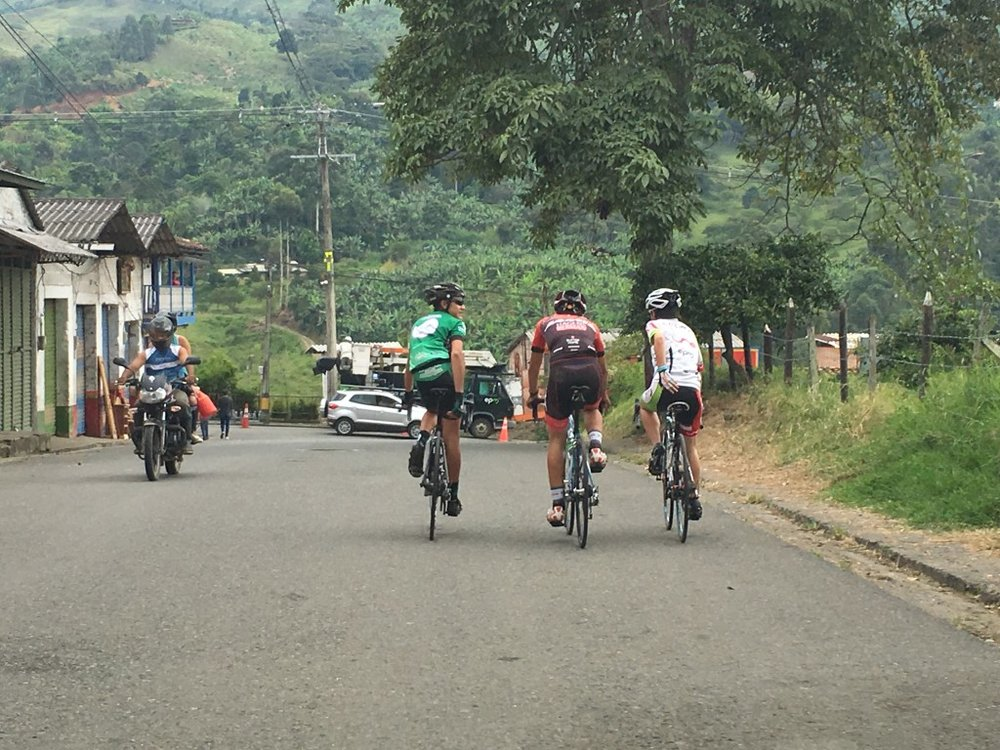 A group of cyclists on the road in Colombia