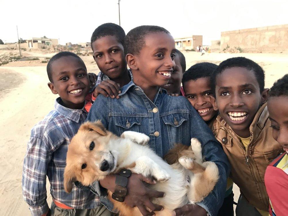 Eritrean children with a dog