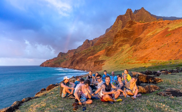 A group of people are celebrating a birthday in Kauai