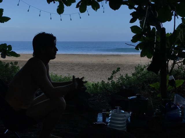 A man on the sandy beach in Kauai