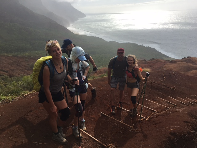 A group of tourists hiking in Kauai