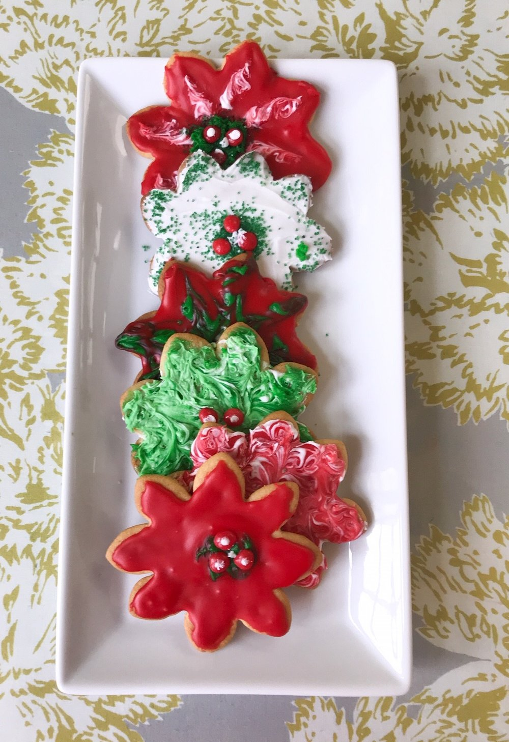 SCW Interiors Life Hacks Blog Post : Poinsettias. A Christmas tradition of mine is to make rolled sugar cookies with my poinsettia cookie cutters. See my favorite recipe from Joy of Cooking.
