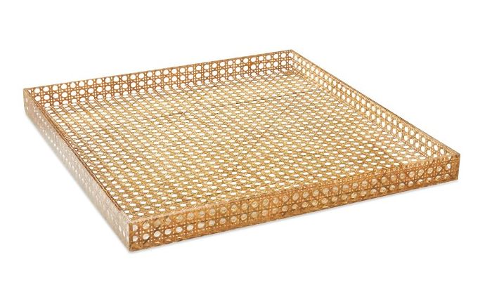 This tray   by Williams Sonoma combines hand-woven rattan with acrylic for a modern, yet casual look.