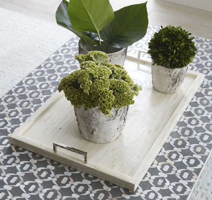 This neutral   bone and nickel tray   by Wisteria is classic and refined.