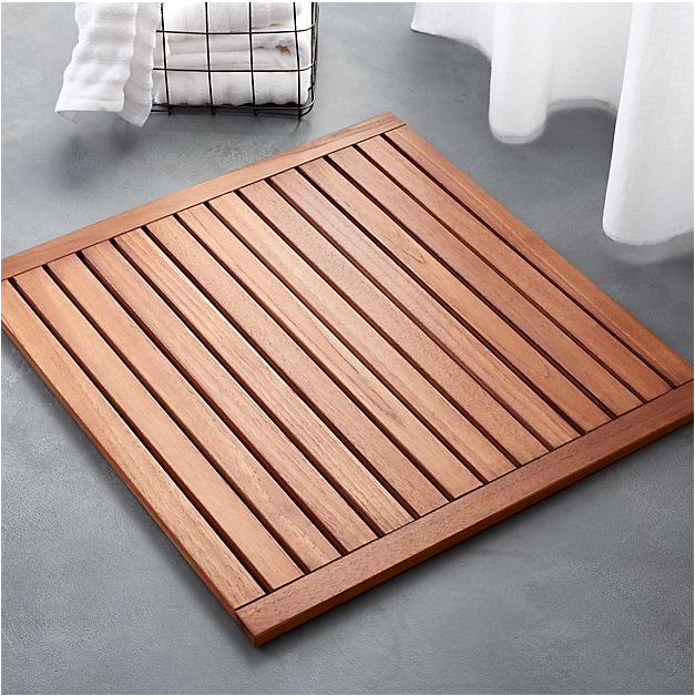 This   Lateral Teak Natural Bath Mat   is available at CB2.