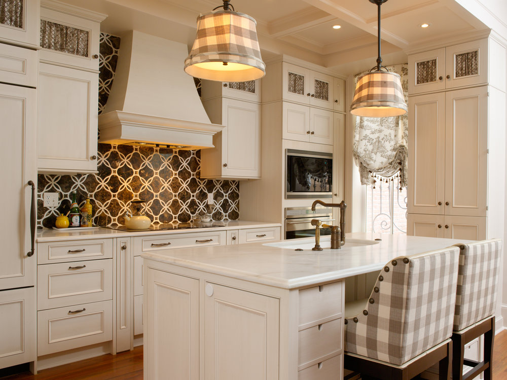 Kitchen with gingham details in the bar stools and fabric pendant shades.