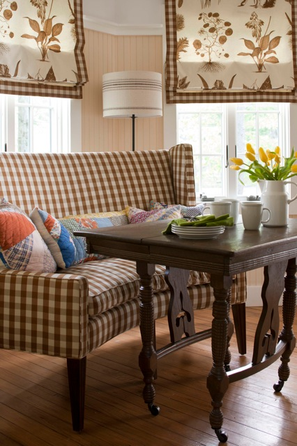 I matched the breakfast banquette fabric to that of the window treatments for a seamless feel throughout this kitchen nook.