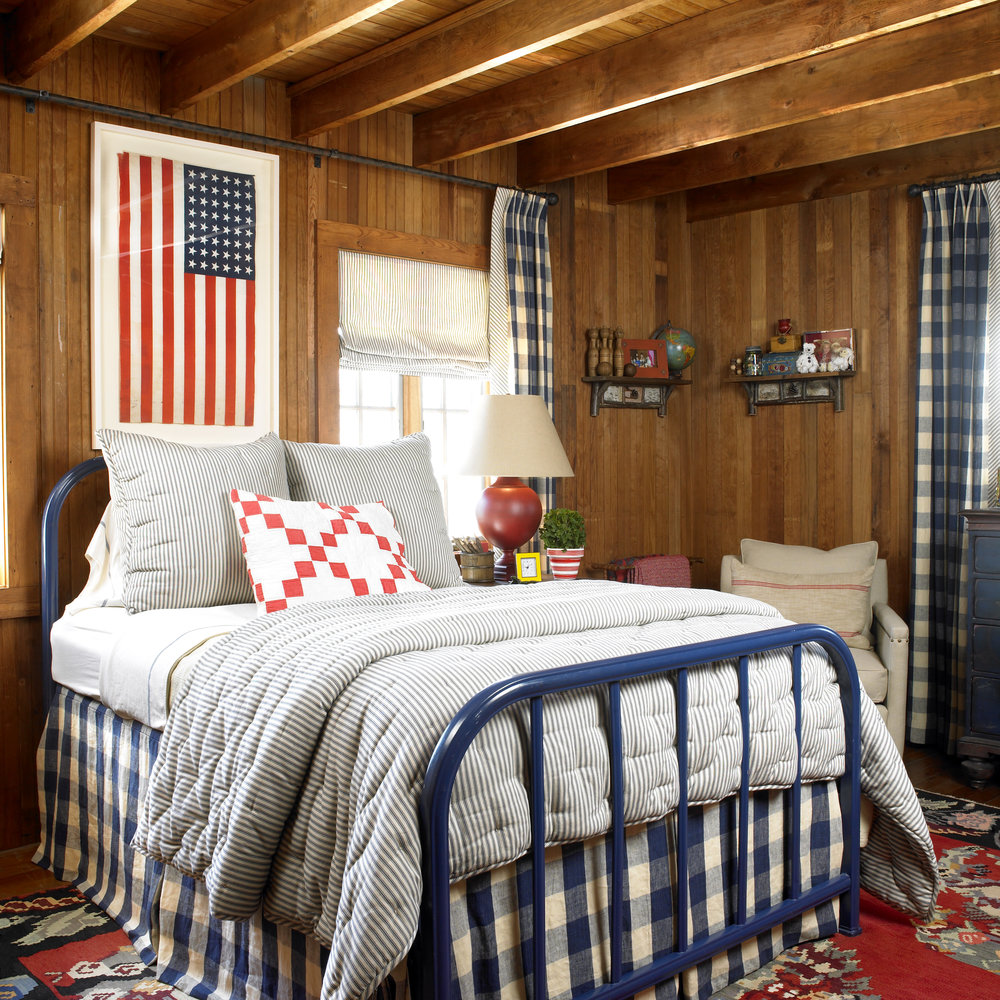 True Americana feel in this cozy bedroom with the royal blue gingham drapes and bed skirt.