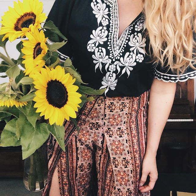 Thrifted and vintage clothes combined in different ways with some sunflowers from my lover.  Off to an allergy specialist this morning to find out what I can do about always getting sick. Hopefully I'm not told to stay away from sunflowers! 🌻 . . . . . . . . . , #vintage #sunflower #sunflowers #blooms #happy #sunny #vintagetop #vintageembroidery #embroideredtop #bohoclothing #bohostyle #boholook #bohemian #vintageboho #vintagebohemian #bohemianstyle #bohemianhair #patternclash #eclecticstyle #eccentric #vintageclothing #vintagefashion